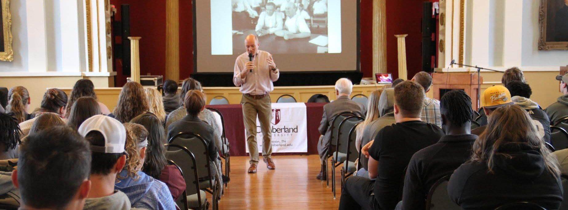 Cumberland speaker giving a presentation