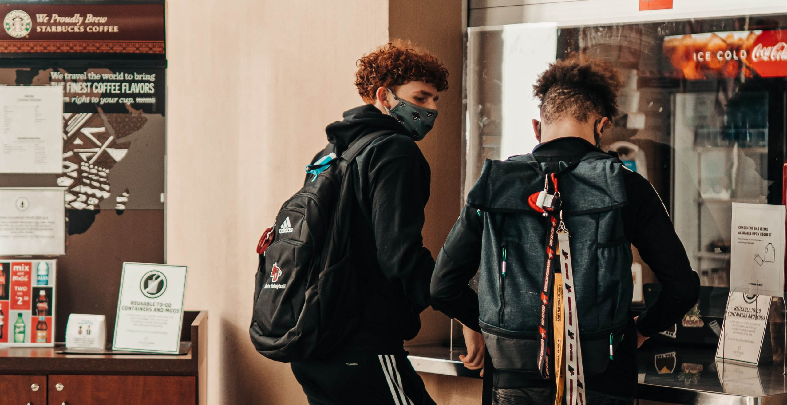 Two male students at Starbucks