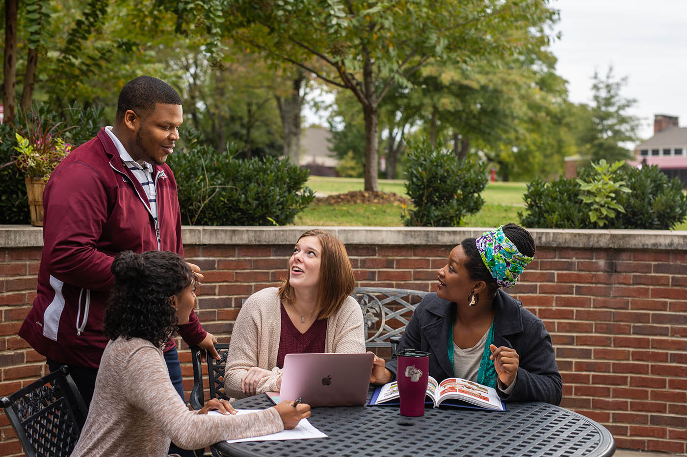 Students smiling at admissions counselor at Cumberland University