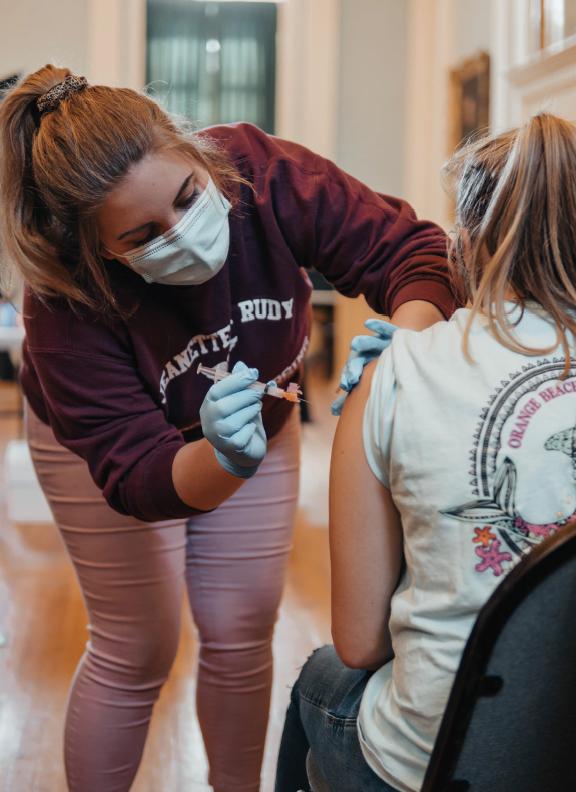 Nursing student administers COVID-19 vaccine